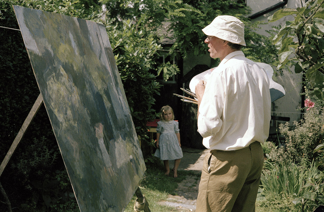 Sargy Mann painting in the Garden of 58 Lyndhurst Grove, Susanna Mann seen in background