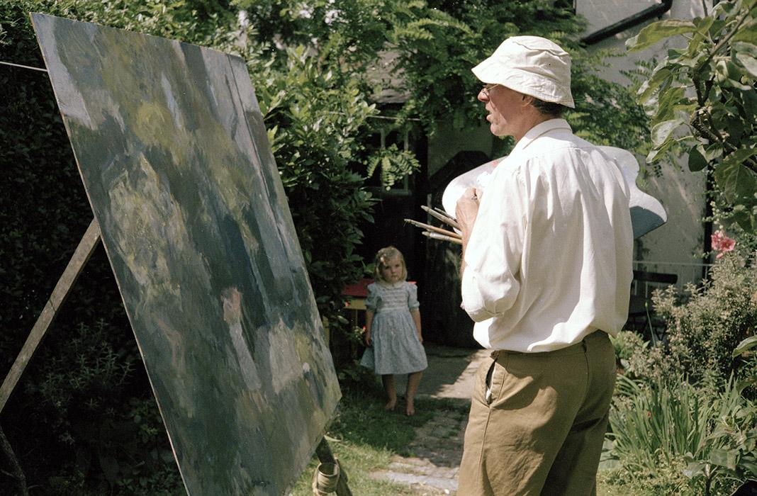 Sargy Mann painting in the Garden of 58 Lyndhurst Grove, Susanna Mann seen in background
